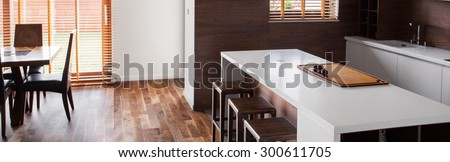 Panoramic photo of kitchen and dinning room - stock photo
