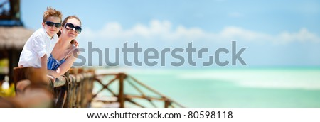 Panoramic photo of mother and son portrait on tropical vacation - stock photo