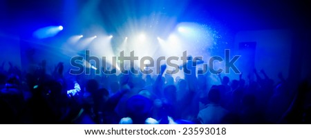 Panoramic photo of people hanging out at the concert, blurred motion - stock photo