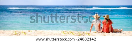 Panoramic photo of romantic couple in tropical paradise - stock photo