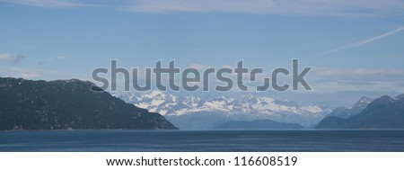 Panoramic photo taken from a cruise ship of Glacier Bay National Park in Alaska