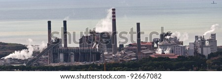 panoramic photography of an industrial complex, while pollutes the environment. - stock photo