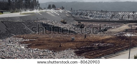 Panoramic picture of a municipal landfill site. - stock photo