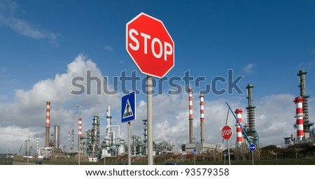 Panoramic picture of a petrol refinery with several traffic signs.Concept of energetic chaos. - stock photo