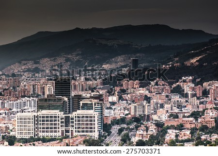 Panoramic picture of Bogota city showing a dark sky due smoke and pollution - stock photo