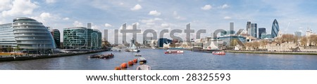 Panoramic picture of City of London with lots of tourists (including City Hall, Gherkin, Tower 42, and HMS Belfast). - stock photo