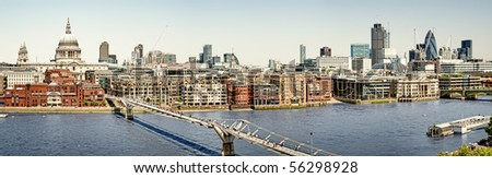 Panoramic picture of St Paul's Cathedral and Millennium Bridge - stock photo