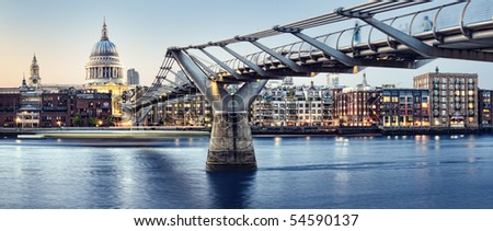 Panoramic picture of St Paul's Cathedral and Millennium Bridge at night. - stock photo