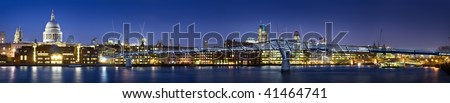 Panoramic picture of St Paul's Cathedral and Millennium Bridge at night.this view also includes tower 42 and Gherkin. - stock photo