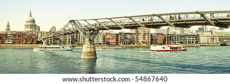 Panoramic picture of St Paul's Cathedral and Millennium Bridge at summer. - stock photo