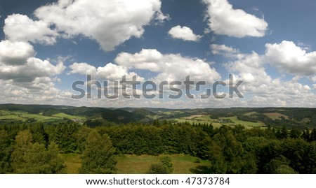 Panoramic picture of the german Hochsauerland mountains (with mount Kahler Asten and others). Picture was made from the Wilzenberg near Schmallenberg/Grafschaft. In the middle the valley Lennetal. - stock photo