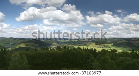 """Panoramic picture of the german Hochsauerland mountains (with mount Kahler Asten & others). Picture was made from the """"holy mountain"""" Wilzenberg near Schmallenberg. In the middle the valley Lennetal. - stock photo"""