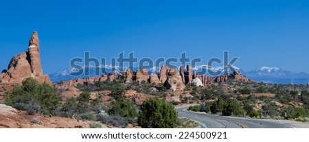 panoramic picture of the road into Parade of Elephants rocks  in  Arches National Park,  Utah, USA - stock photo
