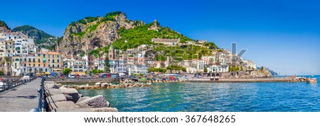 Panoramic picture-postcard view of the beautiful town of Amalfi at famous Amalfi Coast with Gulf of Salerno on a sunny day with blue sky in summer, Campania, Italy - stock photo