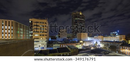 Panoramic rooftop shot of city skyline of Raleigh, North Carolina at night - stock photo