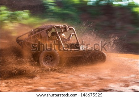 Panoramic scene of mud splash in off-road racing - stock photo