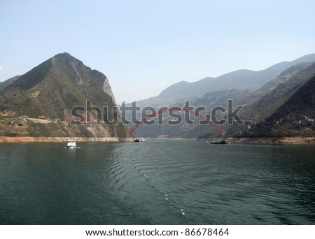 panoramic scenery along the Yangtze River in China including bridge and ships - stock photo