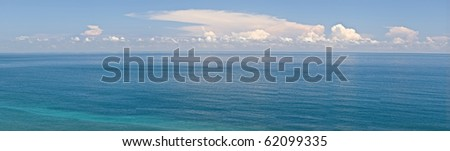 Panoramic seascape with blue water and sky. - stock photo