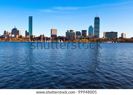 Panoramic shot of Boston in Massachusetts by the Charles River bed on a sunny spring day. - stock photo