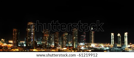 panoramic shot of Dubai downtown at night - stock photo