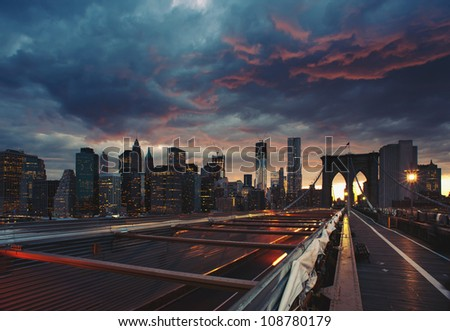 Panoramic shot of Manhattan skyline from the Brooklyn bridge at dusk. - stock photo