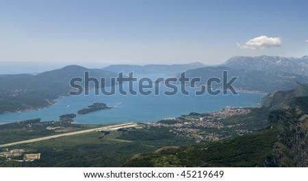 Panoramic shot of Mediterranean Sea, mountains and a  runway - stock photo