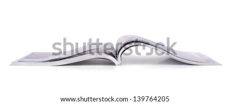 Panoramic shot of open magazine isolated on white - stock photo
