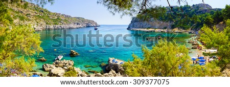 Panoramic shot overlooking the beautiful beach at Anthony Quinn Bay Rhodes Greece Europe - stock photo