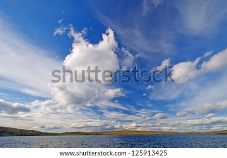Panoramic Skies over Gabamichigami Lake in Minnesota - stock photo