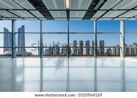 Panoramic skyline and buildings from glass window