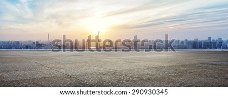 Panoramic skyline and buildings with empty concrete square floor - stock photo