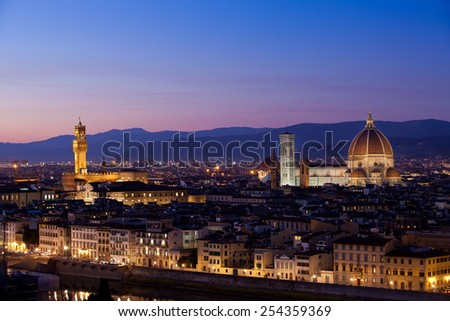 Panoramic skyline at twilight of Florence, Italy dominated by the famous Duomo (Basilica of Saint Mary of the Flower) and the Palazzo Vecchio (originally known as Palazzo della Signoria). - stock photo