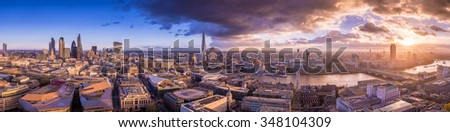 Panoramic skyline of south and east London at sunset with beautiful clouds. - stock photo