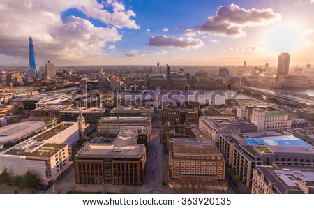 Panoramic skyline view of south London from the top of St.Paul's Cathedral at sunset with blue sky and clouds and River Thames - London, UK - stock photo