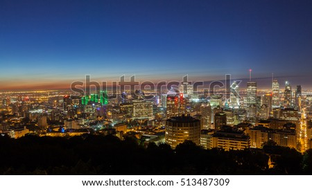 Panoramic skyline view over the city of Montreal at dawn on a summer day seen from the Mount-Royal, Canada