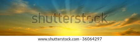 panoramic skyscape with clouds and brilliant sunshine - stock photo