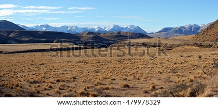 Panoramic Springtime view of Porters Pass & Castle Hill in the Southern Alps of New Zealand.
