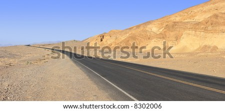 Panoramic Stitch: Mountain And Grassland Scrub In Death Valley - stock photo