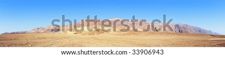 Panoramic Stitch Velvia: Mountain And Grassland Scrub In Death Valley National Park California USA - stock photo