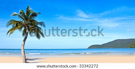 Panoramic tropical beach, blue sea and sky - stock photo