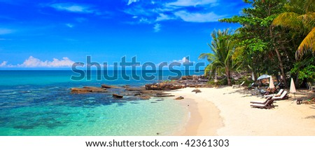 Panoramic tropical beach with palm in family hotel - stock photo