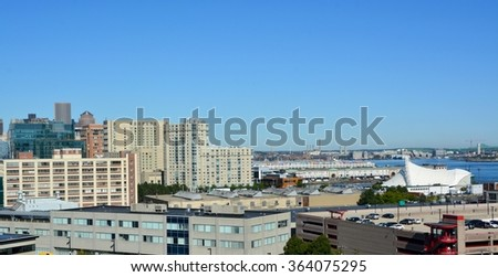 panoramic view across Bostons harbor past the Seaport World Trade center towards East Boston; Boston, MA USA  - stock photo