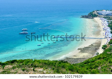 Panoramic view and activity on the beach in Koh Lan Island of Pattaya City, Thailand - stock photo