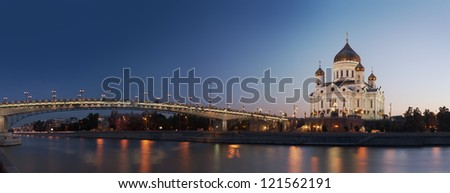 Panoramic view at orthodox Cathedral of Christ the Saviour and Moscow river illuminated at evening, Moscow, Russia