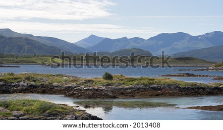 Panoramic view at small islands and mountains; Norway, Averoy, Atlantic road. - stock photo