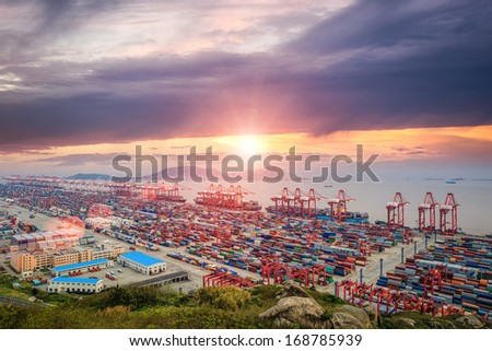 panoramic view busiest container port in sunset - stock photo
