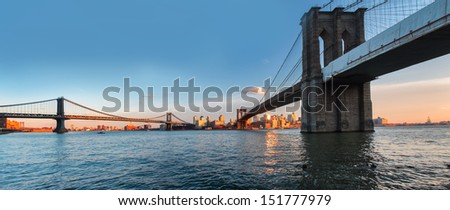 Panoramic view from Manhattan to the Brooklyn bridge - stock photo