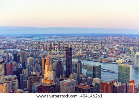 Panoramic view from Observatory deck of the Empire State Building on Midtown district of Manhattan in New York. East river and New York Queensboro Bridge in Long Island City are on the background. - stock photo