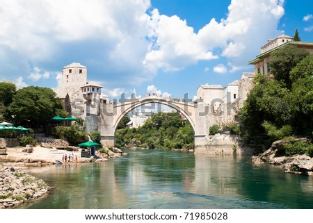 Panoramic view from river Neretva and Old bridge in Mostar, Bosnia and Herzegovina - stock photo