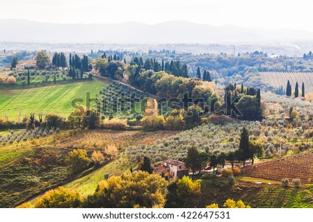Panoramic view from San Gimignano in autumn, Tuscany, Italy - stock photo
